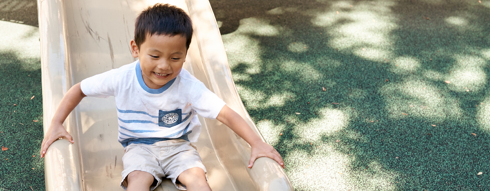 boy sliding on playground