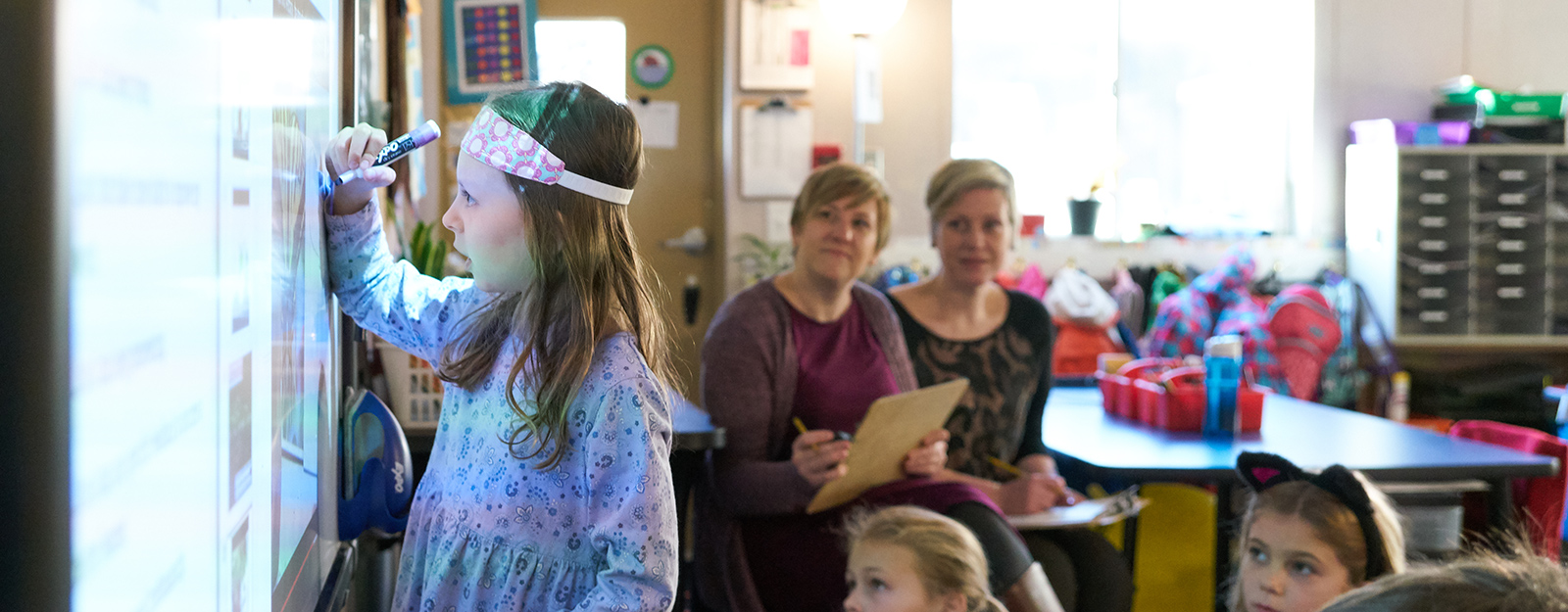 Marcus Autism Providers Observing Classroom