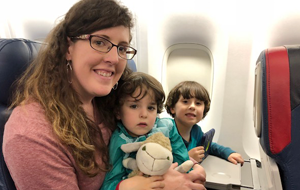 mom-with-sons-on-airplane