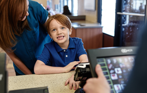 boy-ordering-at-check-out-counter